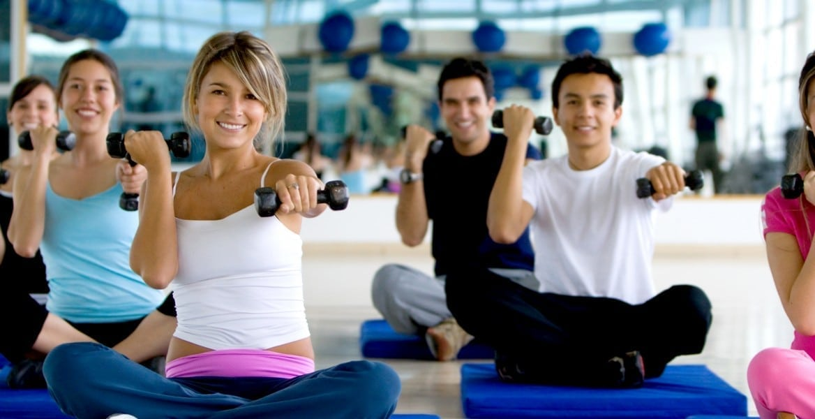 group exercise class using hand weights